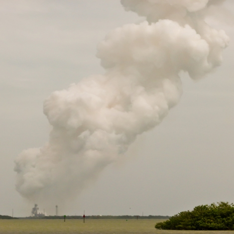 Spiral Cloud of Rocket Exhaust Looms over Pad-39A. STS-135 Launch